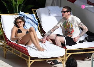Kaia Gerber in tiny wet black bikini tongue kissing Pete Davidson in Miami Beach Pool Celebs.in Exclusive 019