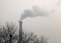 A chimney emits smoke in Beijing November 30, 2009. (Credit: Reuters/David Gray) Click to Enlarge.