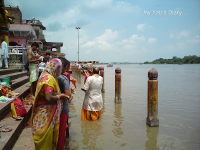 Devotees performing rituals for ancestors at the Yamuna River Ghat, Mathura