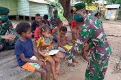 Peringati Hari Buku Nasional, Yonif 411 Kostrad Bagikan Buku Bacaan di Perbatasan RI-PNG