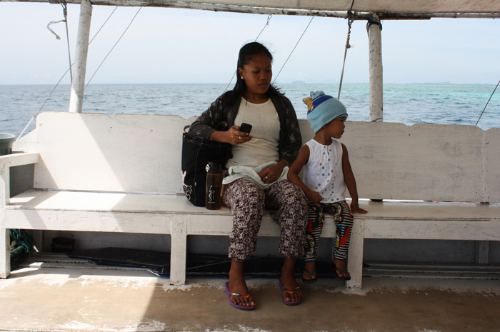 Mother and daughter riding a boat to Matalom