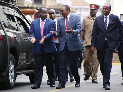 Fred Matiang'i with the President Uhuru Kenyatta. PHOTO | FILE