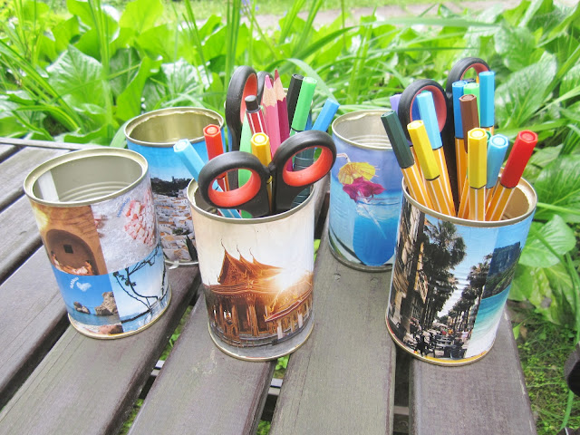 Decoupage cans for holding pencils.
