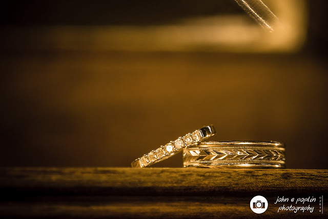 a photography of the bride and grooms rings before the wedding ceremony