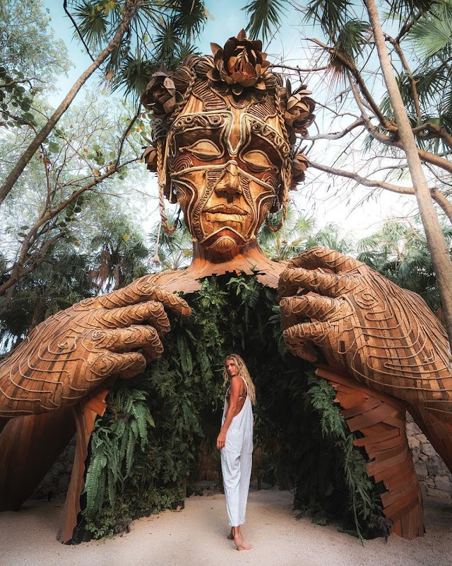 Magical resort with giant wooden dummy in Mexico old town