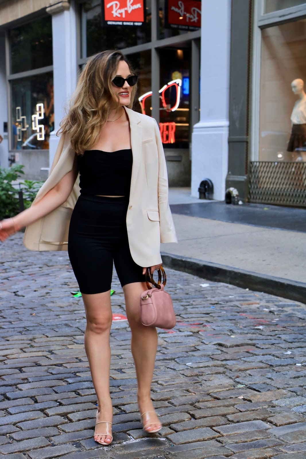 Nyc fashion blogger Kathleen Harper wearing a bike shorts and blazer outfit.