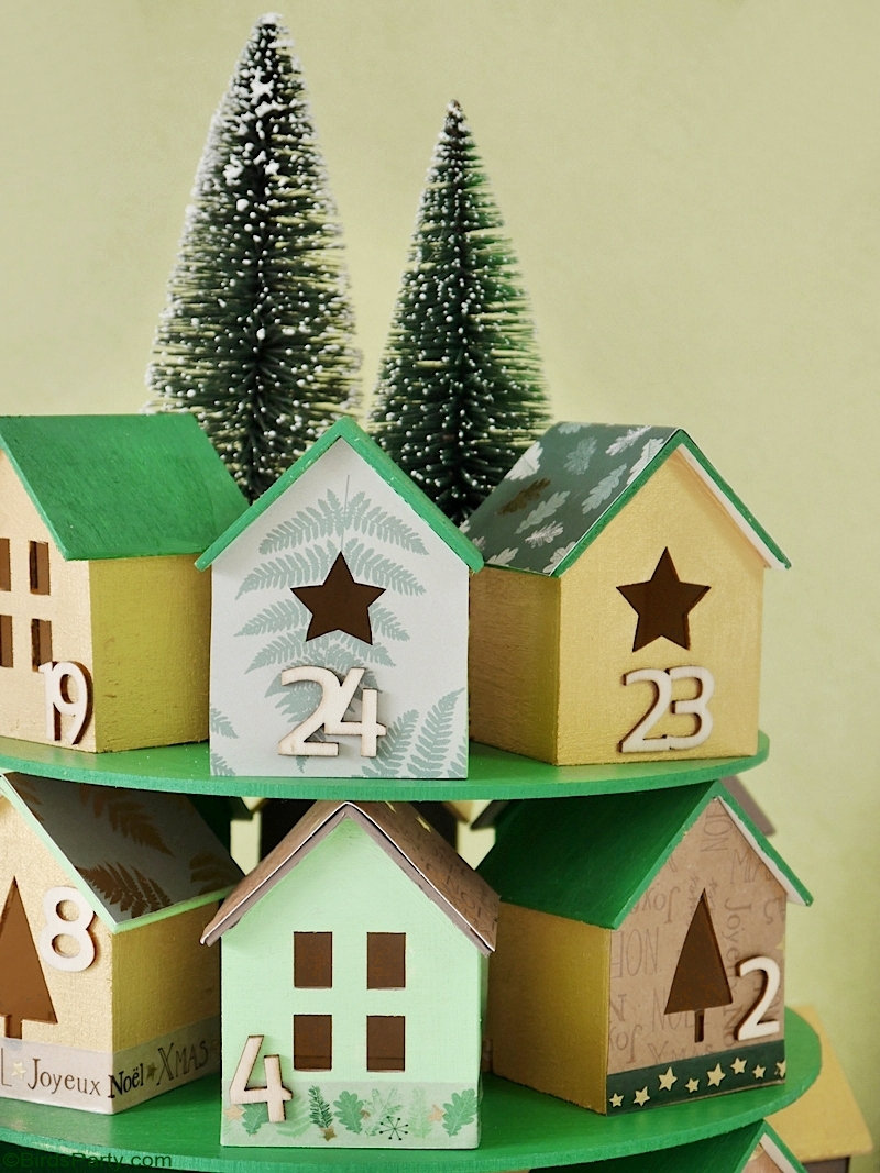 DIY Christmas Village Advent Calendar - easy, inexpensive and super pretty craft ideas to make with the kids for Christmas! by BirdsParty.com @birdsparty #adventcalendar #christmasvillage #christmas #christmascrafts #diy #crafts #holidaycrafts
