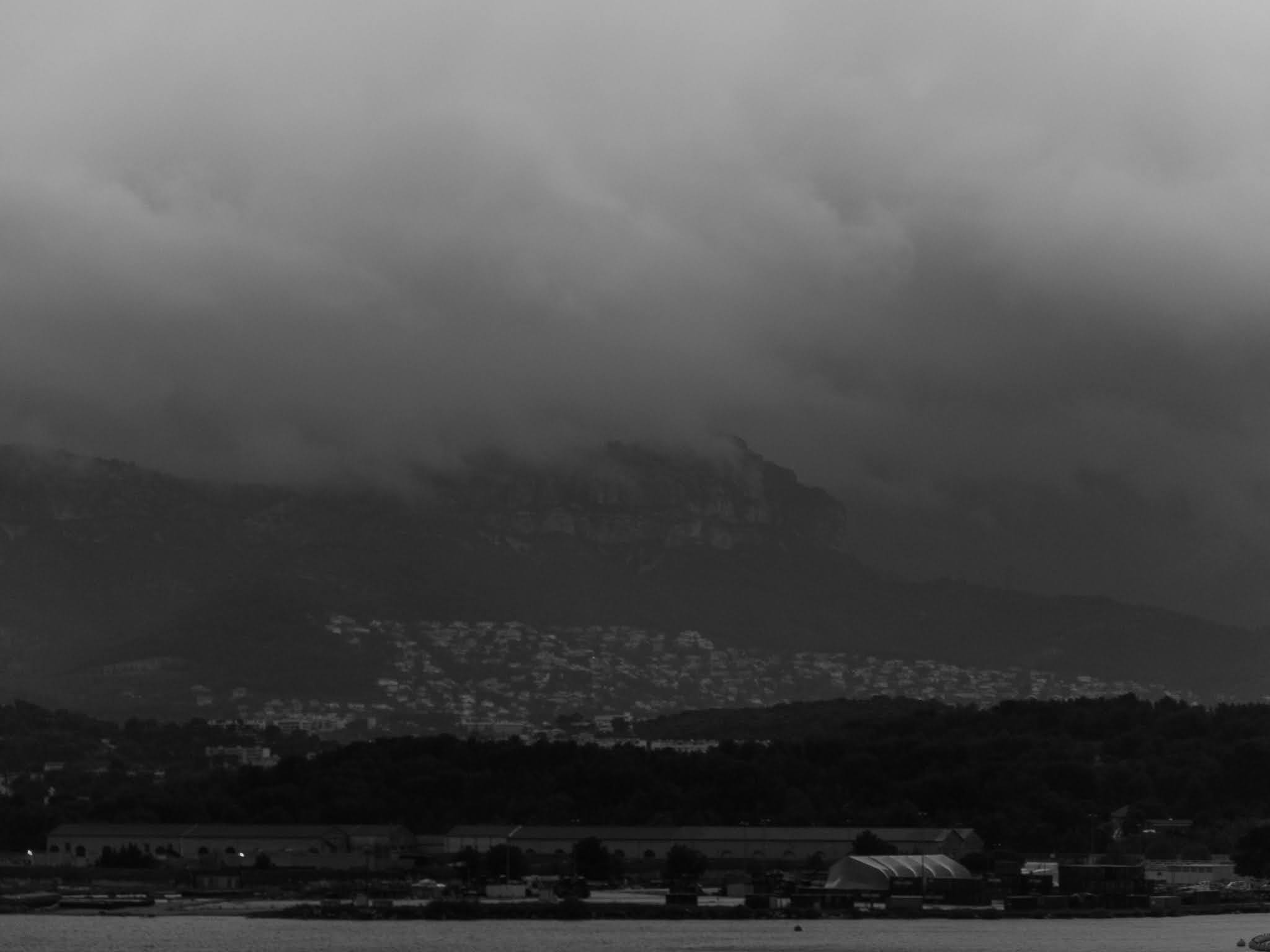 Moutnainside city Toulon on a cloudy morning.