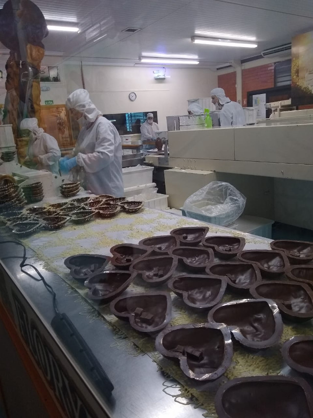 Heart shaped chocolates being produced.