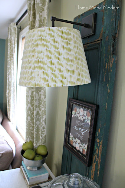 hang a sconce on a shutter