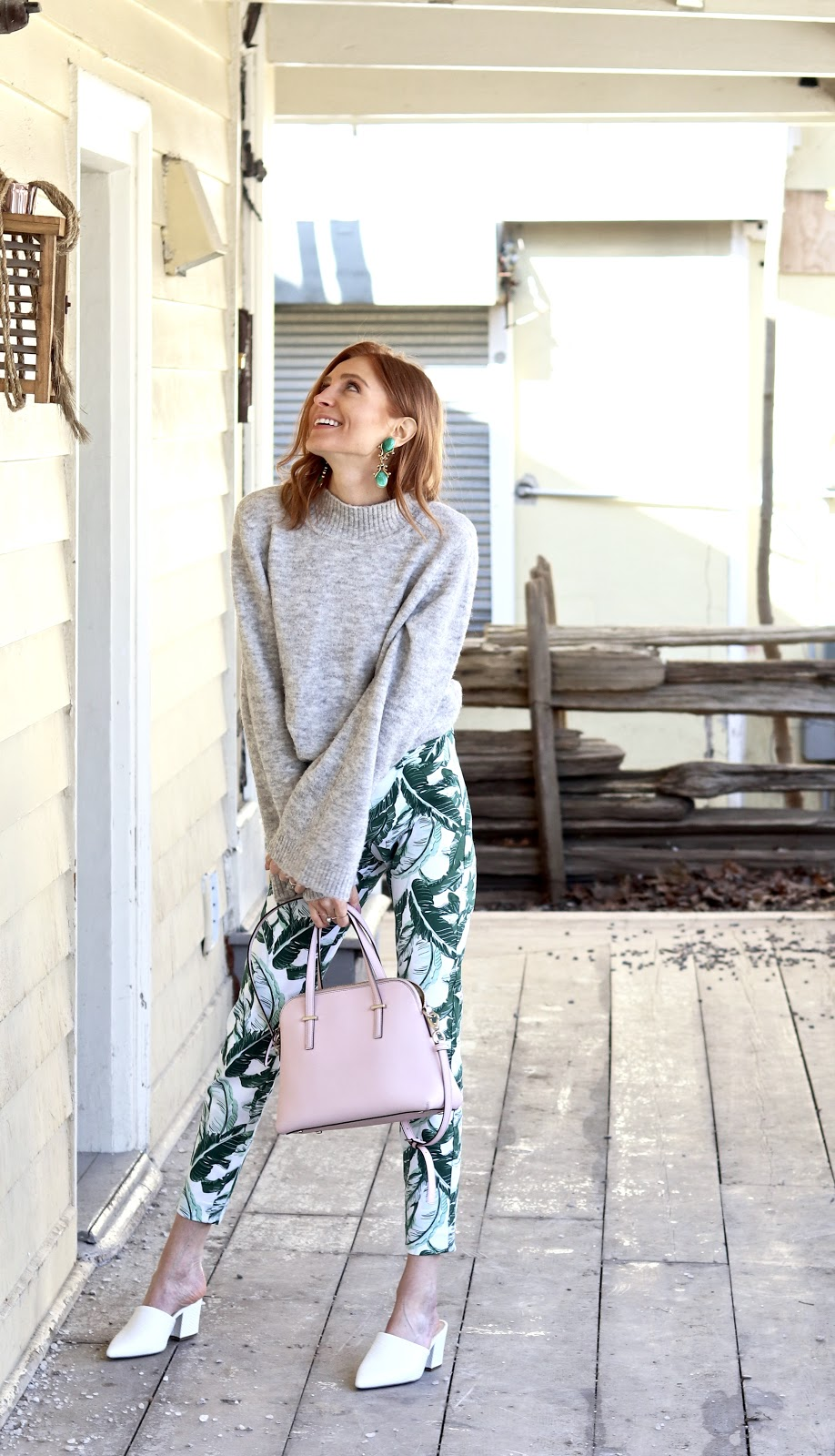 Winter to Spring Dressing, Spring pastels, grey turtleneck flared sleeves, palm print pants Old navy, Kate Spade bag, Expressions white block heel mules