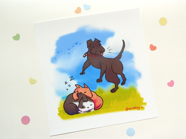 A photo showing a custom art print featuring a dog and two sleeping cats