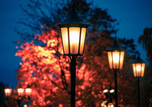 Three Lamp Posts at Night | Photo by John Christian Fjellestad via Unsplash
