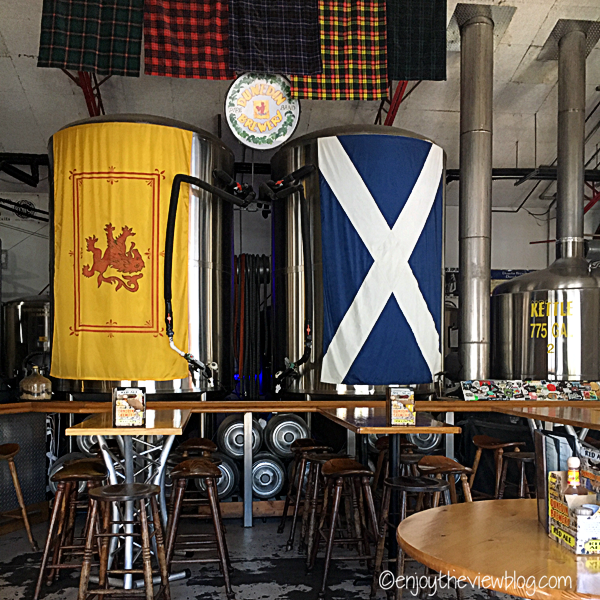Scottish flags and tartans in a bar
