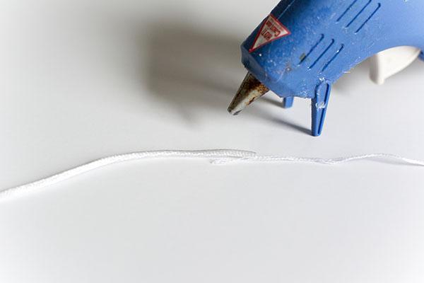 blue hot glue gun with white cord