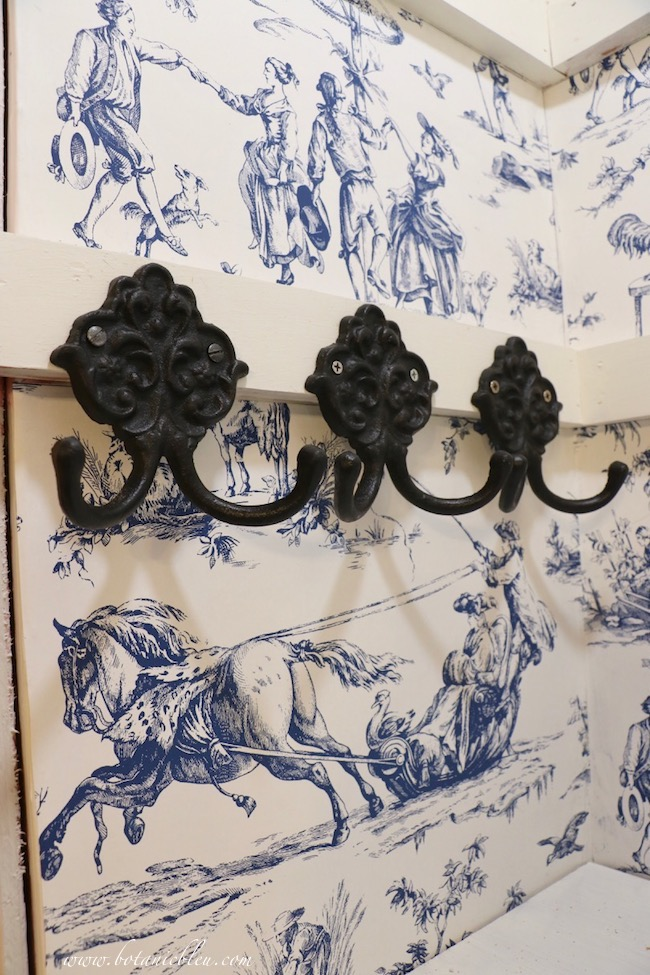 Toile pantry updated with black iron double hooks for holding spare keys