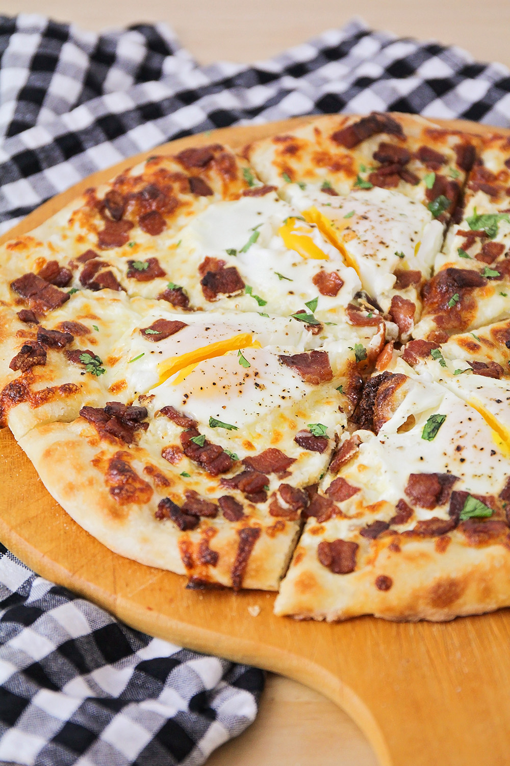 This bacon breakfast pizza is perfect for any meal of the day! It's so flavorful and delicious, and easy to make too!