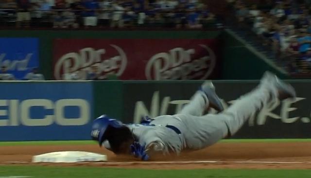 Yasiel Puig scrapes face sliding into third base