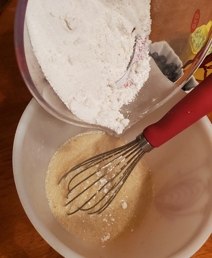 this is mixing ingredients together to make muffins in two bowls