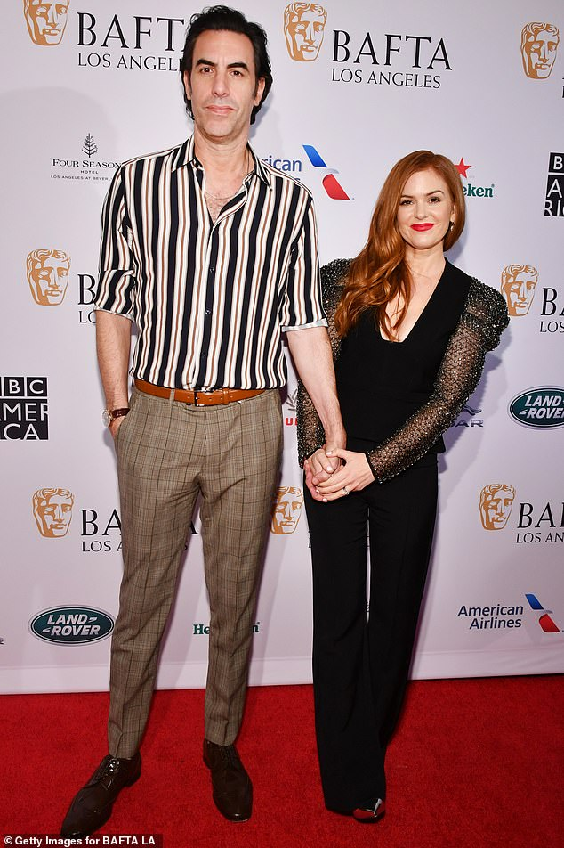 Isla Fisher arrives in black at the BAFTA Los Angeles Tea Party with Sacha Baron Cohen