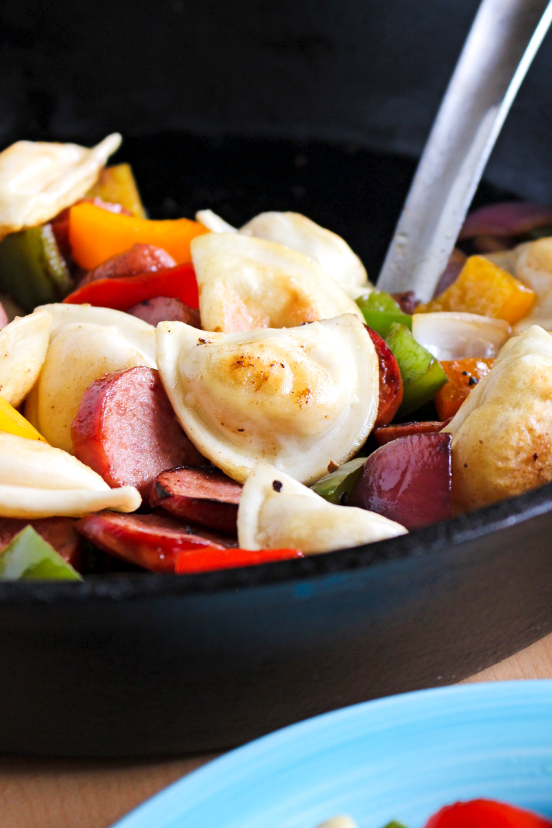 Kielbasa, Pepper, Onion, and Pierogy Hash is a simple and easy to prepare recipe that is on the table in less than 30 minutes. It's the perfect family meal for busy days!