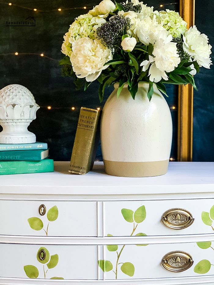 A thrifty dresser gets a painted makeover with eucalyptus leaves.