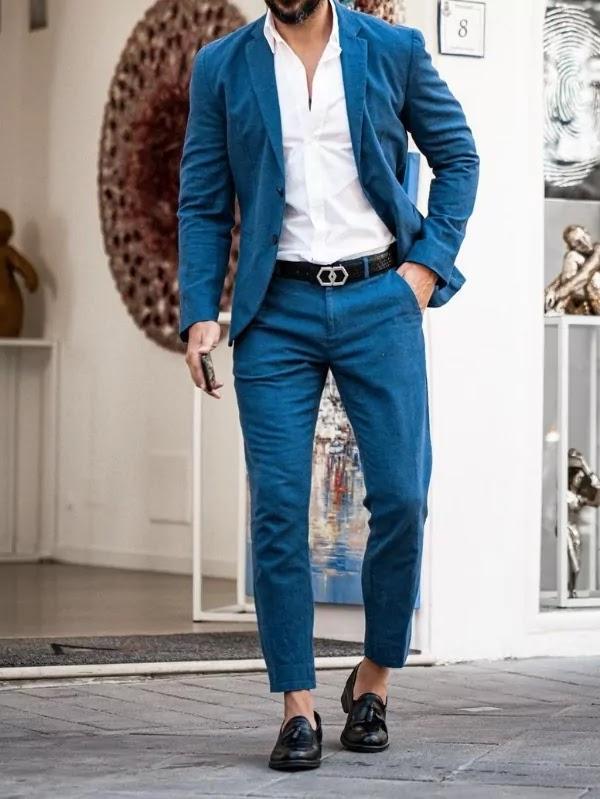 Cobalt blue colour suit with white shirt.