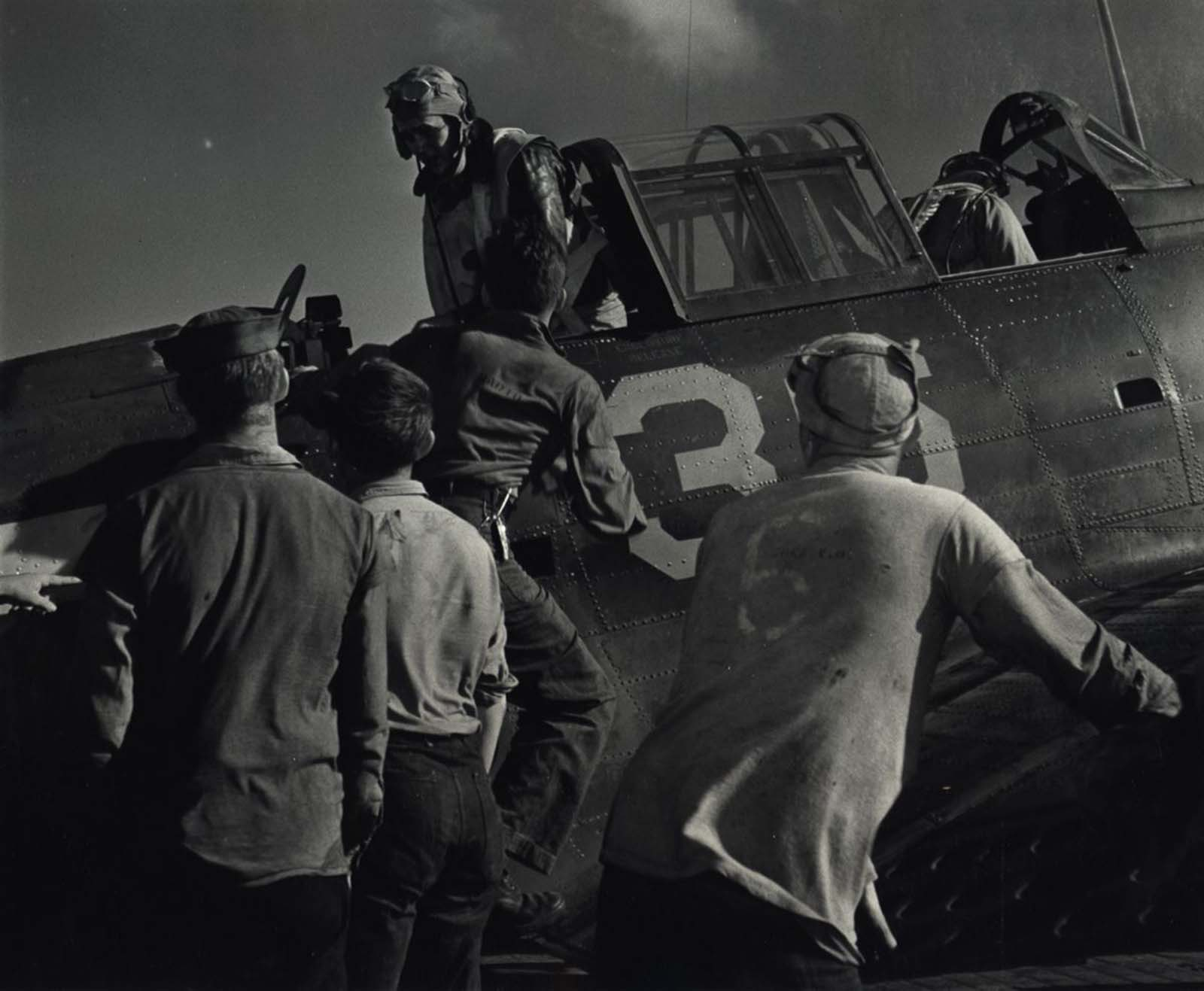 Men Getting in Aircraft, c. 1943.