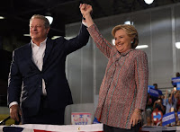 Hillary Clinton and Al Gore appear at a campaign event in Florida, imploring the state's voters to consider climate change a pivotal election issue. (Credit: Getty Images) Click to Enlarge.
