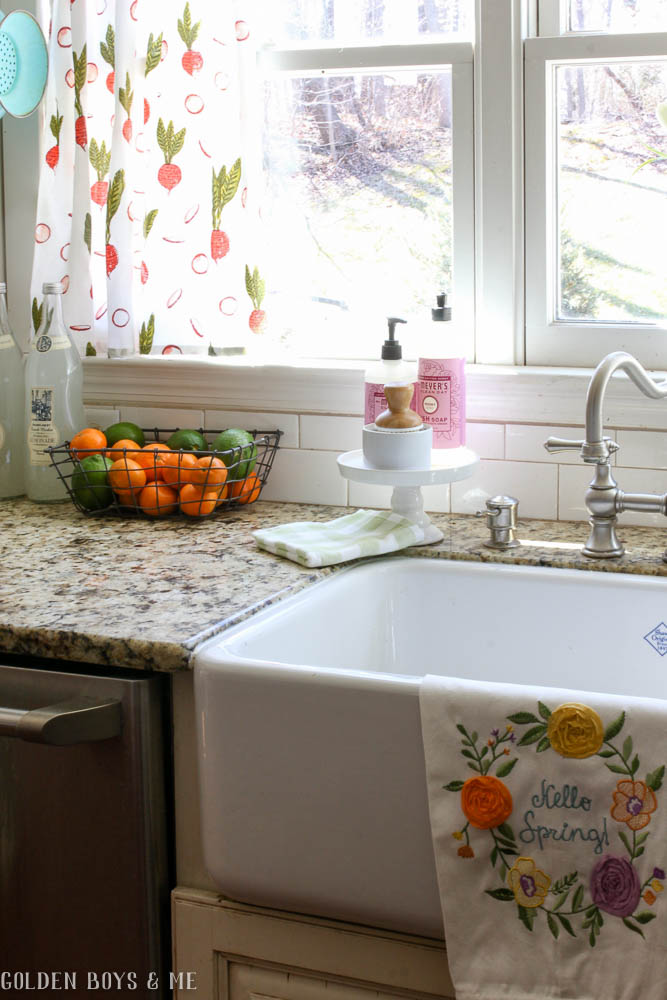 Farmhouse sink in spring kitchen with flour sack curtains