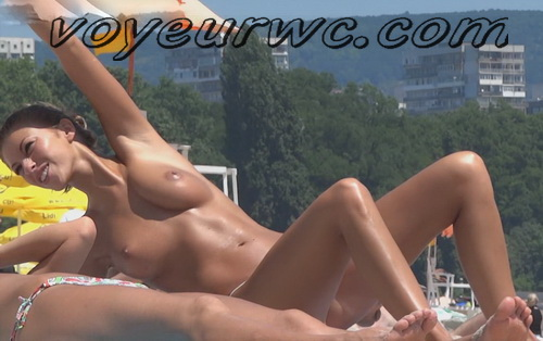 NudeBeach France 1 (Many naked girls show their assets by the sea in voyeur nude beach)
