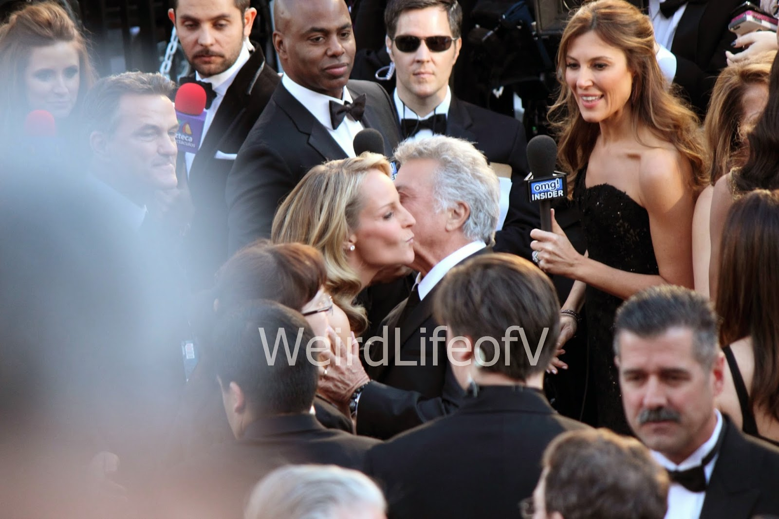 Helen Hunt and Dustin Hoffman greet each other with cheek kisses on the 2013 Oscars red carpet