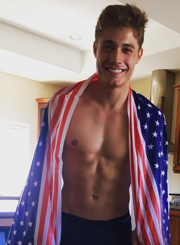 adorable-male-model-smiling-shirtless-usa-flag-american