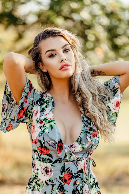 beautiful-girl-plugging-floral-dress-outdoors