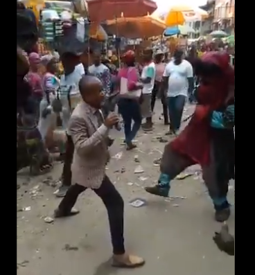 [VIDEO] Watch moment Pastor and masquerade go toe-to-toe while 'evangelizing' in market square