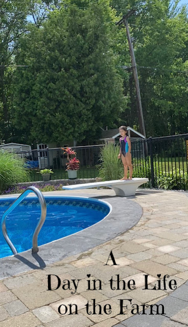girl on diving board at pool