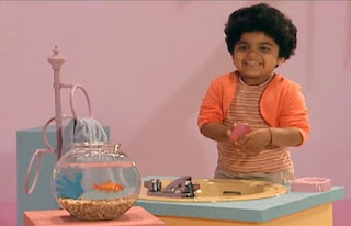 a child washes his hands with a bar of soap and dry them with a towel. Sesame Street Elmo's World Hands Kids and Baby