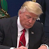Trump signs executive order on revised travel ban - Iraq removed from the list
