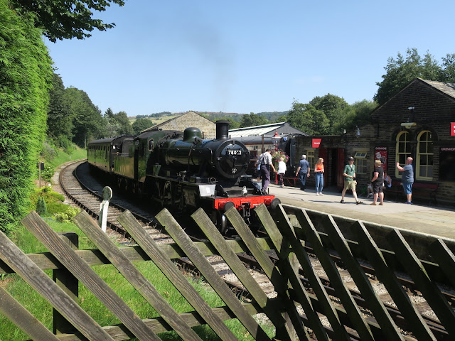 Steam engine and carriages at Oxenhope Station, Keighly and Worth Valley Railway