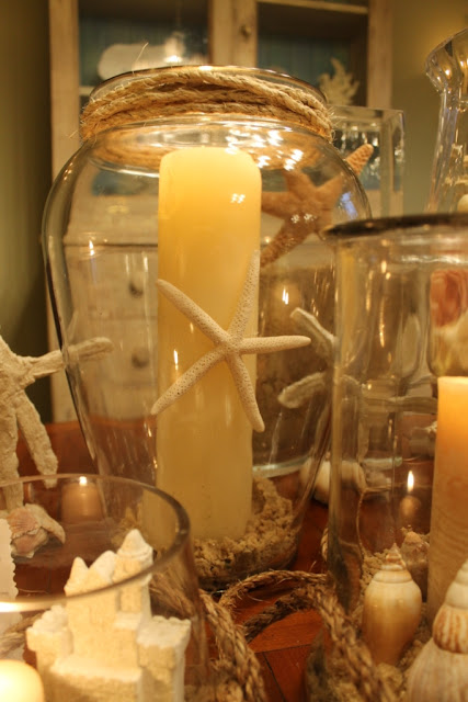 tall candles can act as stands for smaller items