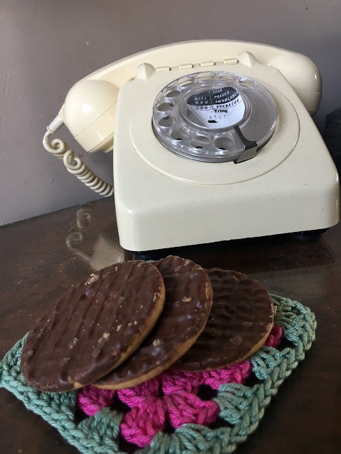vintage phone and chocolate biscuits