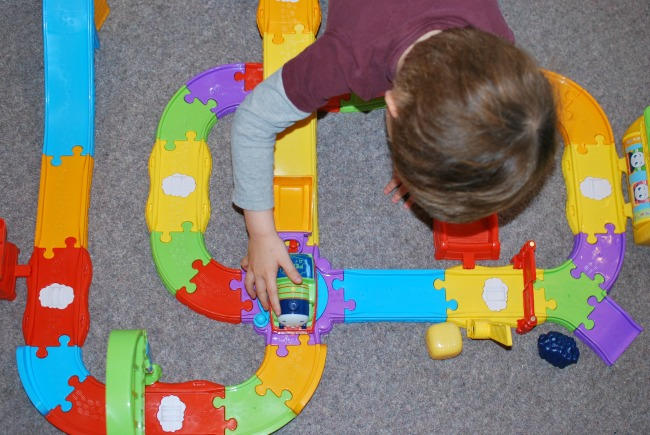toddler-playing-with-fisher-price-my-first-thomas-&-friends-railway-pals-percy-engine-on-the-turn-table