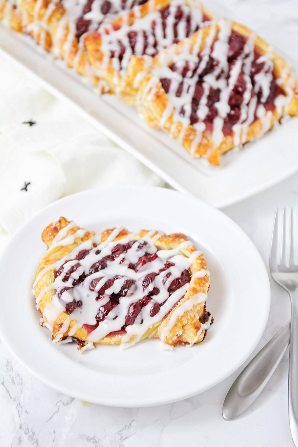These cherry pie pastries are delicious and easy to make! They're perfect for breakfast or dessert!