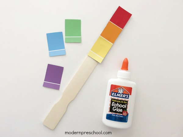 Rainbow paint chip fine motor color matching busy bag for toddlers and preschoolers.  Simple activity with free supplies!