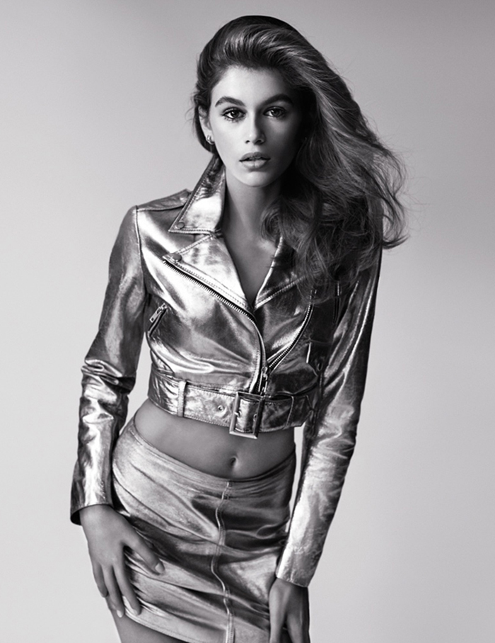Image of hollywood model kaia gerber in silver lame skirt and jacket for a photoshoot