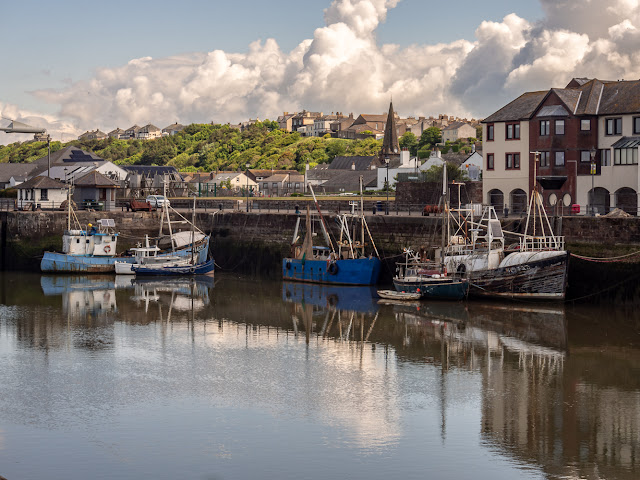 Photo of reflections in Maryport Harbour