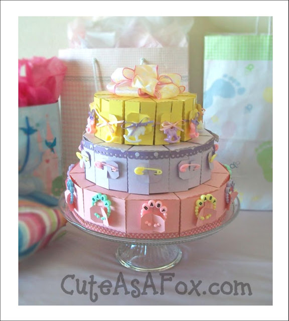 baby shower slice cake all made out of paper and cute baby things