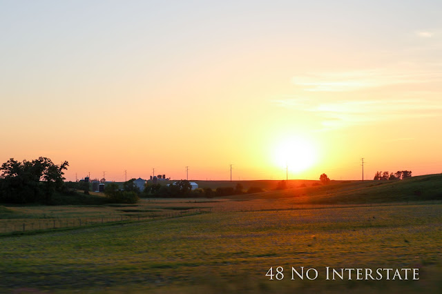 48 No Interstate back roads cross country coast-to-coast road trip Iowa farmland sunset barn