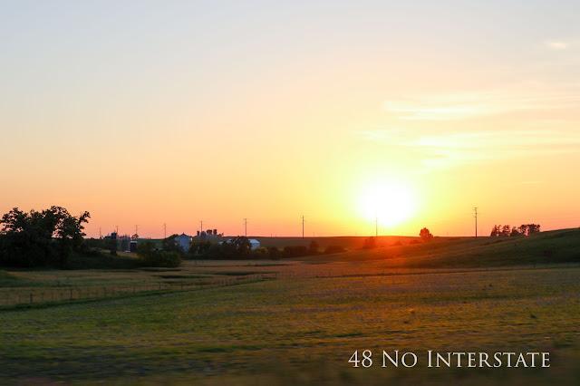 48 No Interstate back roads cross country coast-to-coast road trip Iowa farmland sunset barn