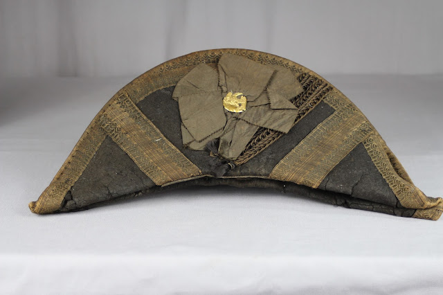 Before treatment photo of military chapeau. The hat would be conserved by textile expert Gwen Spicer at Spicer Art Conservation. SAC conserves and preserves military antiquities, collectibles and memorabilia